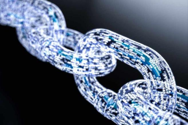 3219357-blockchain-bitcoin-657-438
